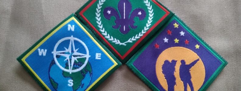 Advancement badges on Khaki web