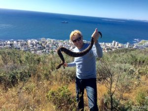 Braam Malherbe holding a snake on appleton