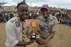 KZN Rally  online- national youth representative Henry Sibande hands over award to winning Cub Pack Scouter Ntuthu Jobela credit steve camp