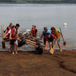 Scouts pulling raft out of water