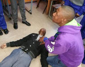 sethu teaching first aid during a SiS meeting