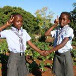 two girls salute